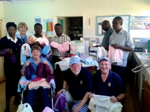 Caterham Rotarians (L to R) in front row Colin Vane and Geraint Jenkins with Colin's wife Peggy (2nd from left back row) and members of C.H.E.C.K. and hospital staff including the Kimilili Hospital Matron (far left) and the Medical Superintendent  (back row centre)