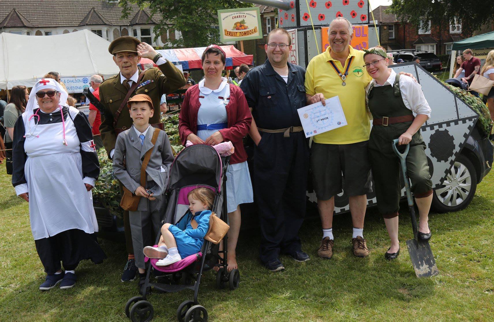 """Caterham Rotary President Andy Parr presenting 1st prize to the local residents with their """"Those not forgotten"""" float."""